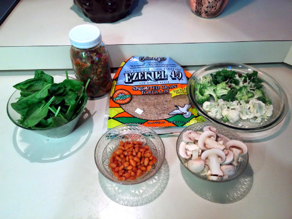 Sprouted grain & seed tortilla, broccoli, cauliflower, mushrooms, cooked pinto beans, spinach, and homemade pico de gallo.