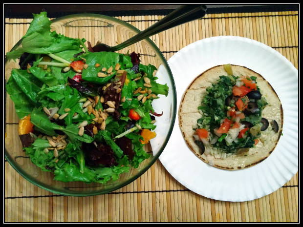 Spinach-potato taco over mixed green and berry salad.