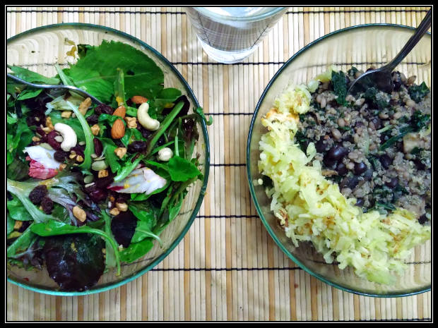 Black beans and rice with hash browned potatoes and a mixed green and berry salad.