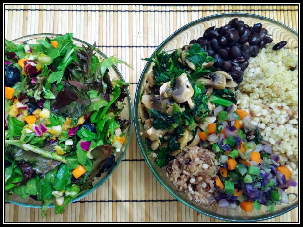 Sections of beans, grains, and veggies with a mixed green salad.